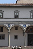 ******** Loggia (exterior gallery) designed by Filippo Brunelleschi (1420-27) and ceramic roundels with 'putti' (babies) by Andrea della Robbia (1490) - detail after 2013-2017 restoration works