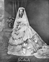 ******** Royal wedding 1863 - Princess Alexandra. Queen Alexandra, formerly Princess Alexandra of Denmark (1844 - 1925), and then Princess of Wales, consort of King Edward VII pictured in her wedding gown for her marriage to Albert Edward, Prince of Wales on 10 March 1863 at St. George's Chapel, Windsor.. Photograph by Mayall in Lady's Pictorial, 6 July 1901.1863