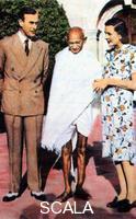 ******** Mohondas Karamchand Gandhi (1869-1948), standing between Lord and Lady Mountbatten