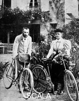 ******** Pierre and Marie Curie, French physicists, preparing to go cycling.
