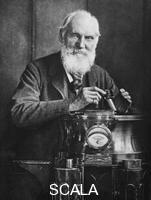 ******** Lord Kelvin, Scottish mathematician and physicist, with his compass, 1902.