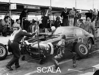 ******** Stirling Moss in a Ferrari, Goodwood, 1961.