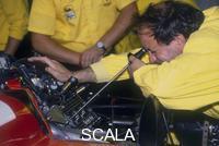 ******** Mechanic at work in the Ferrari pits, 1988.