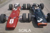 ******** Chris Amon and Jackie Stewart at the British Grand Prix, Silverstone, Northamptonshire, 1967.